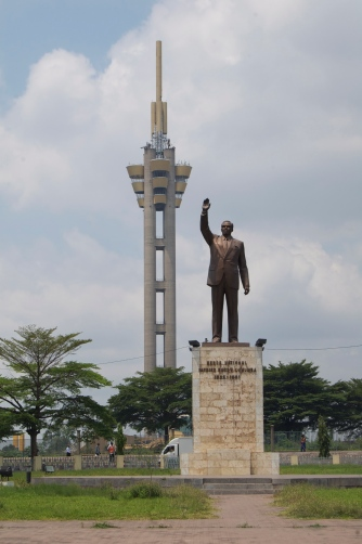 The Tour de l'Echangeur and the statue of Patrice Lumumba, the first democratically elected leader of the Congo who was deposed in a coup and subsequently executed.