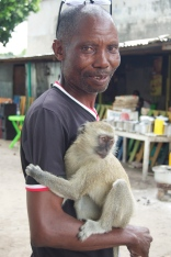We visited the Marché de Voleurs (theives market) where this man was selling this monkey for $150.